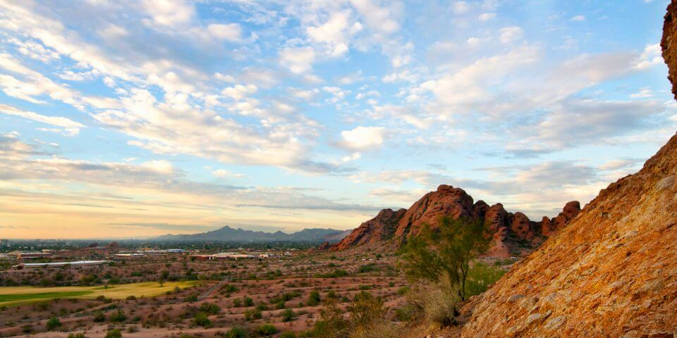 The Papago mountains show red under a beautiful blue sky in Phoenix, Arizona.