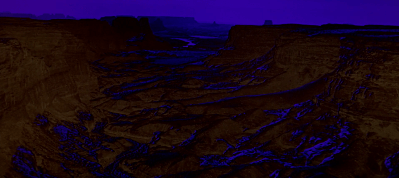 A dark still from Stanley Kubrick's 2001: A Space Odyssey. A movie filmed in Monument Valley.
