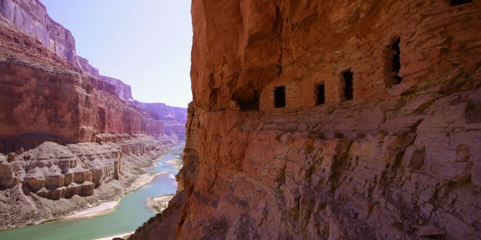 Pueblo native ruins along the side of a Grand Canyon cliff.