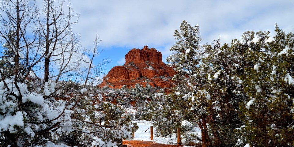 The red rocks of Sedona, Arizona with snow in the foreground.
