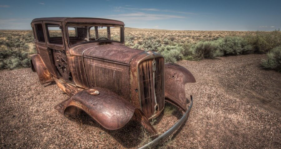 An old car is preserved in the Painted Desert.