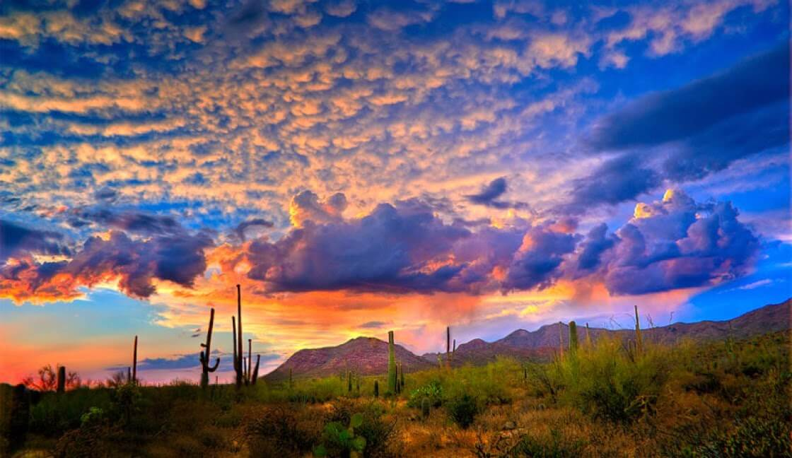 Pictures of Arizona sunsets are the best, including this one of a pink, blue, and orange sky above the desert.