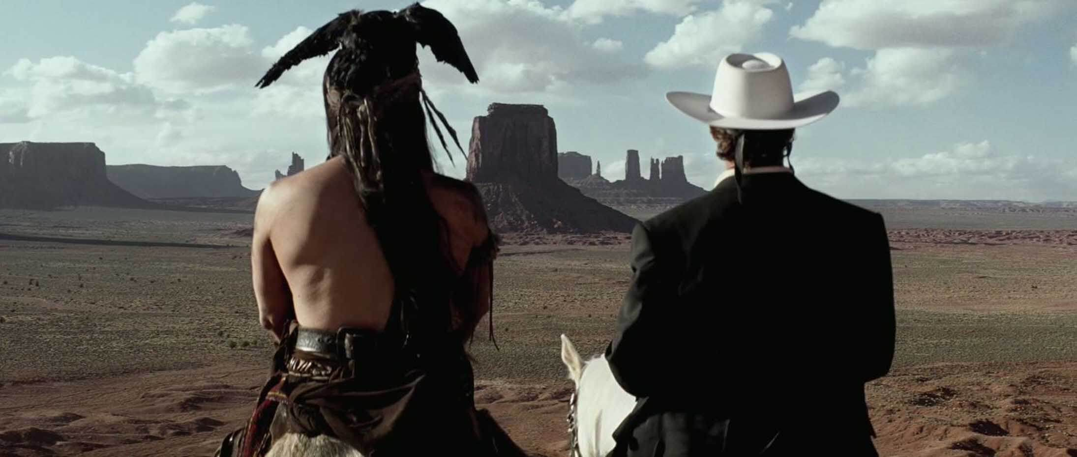 The Lone Ranger and Tonto look out over Monument Valley in the movie The Lone Ranger.