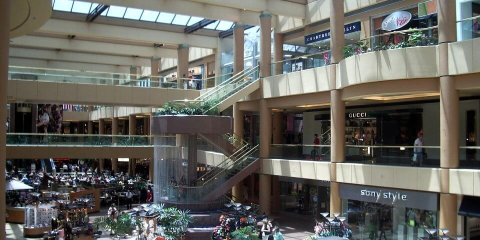 Interior shot of shoppers walking around the Scottsdale Fashion Square mall.