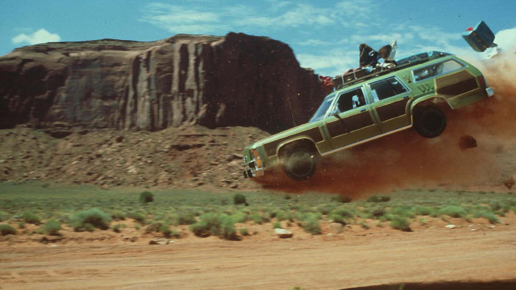 The Griswold's car in National Lampoon's Vacation movie is launched into the air in Monument Valley.