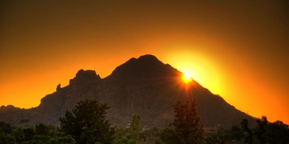 Phoenix's Camelback Mountain silhouetted during sunset.