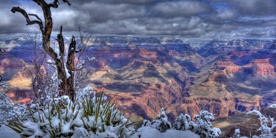 Winter at the Grand Canyon giving an excellent contrast of high desert and snow.