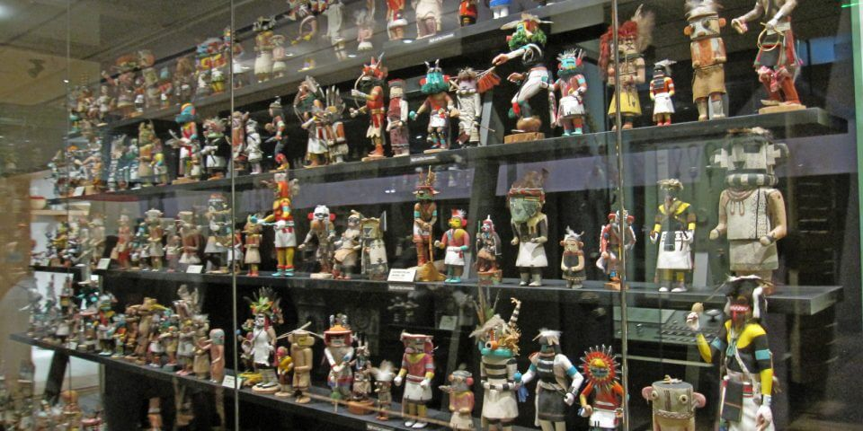 Kachina dolls behind glass cases at the Phoenix Heard Museum of Native Cultures and Art.
