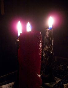 Black and red burning Hoodoo Candles.