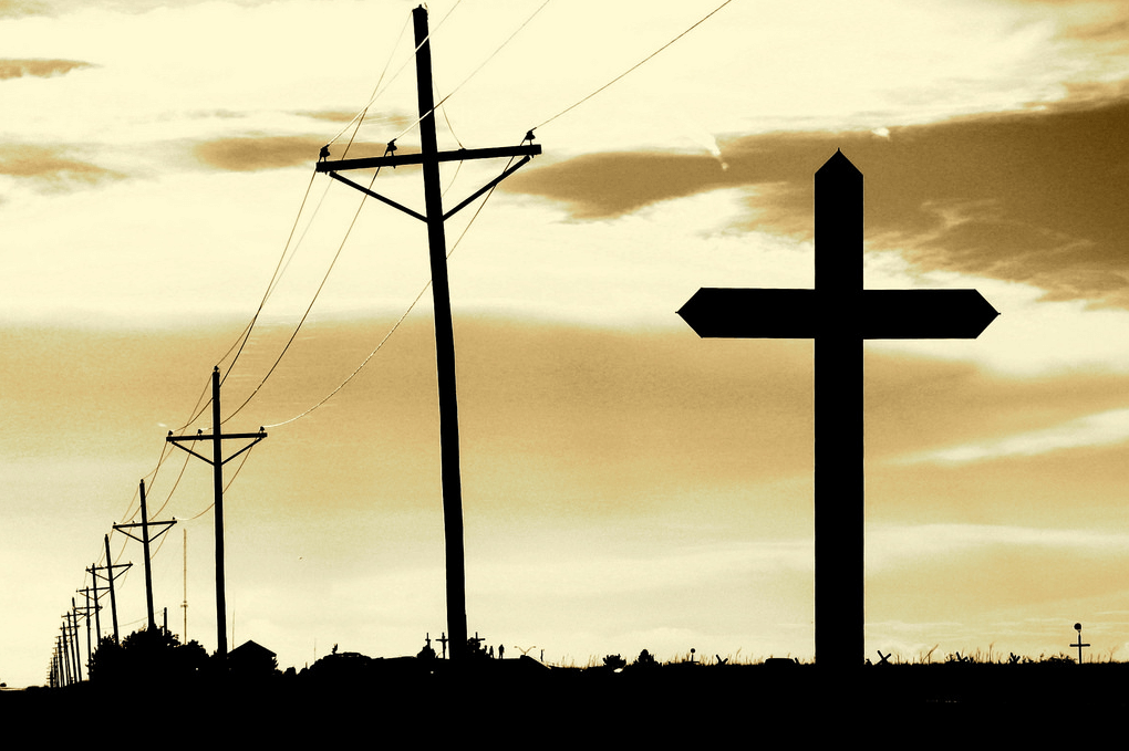 A silhouette photo of the Groom Cross in Texas. Flickr User: cgpgrey