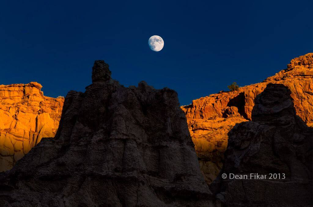 moon over Sandstone Hills near Abiquiu, New Mexico - Photo by dfikar