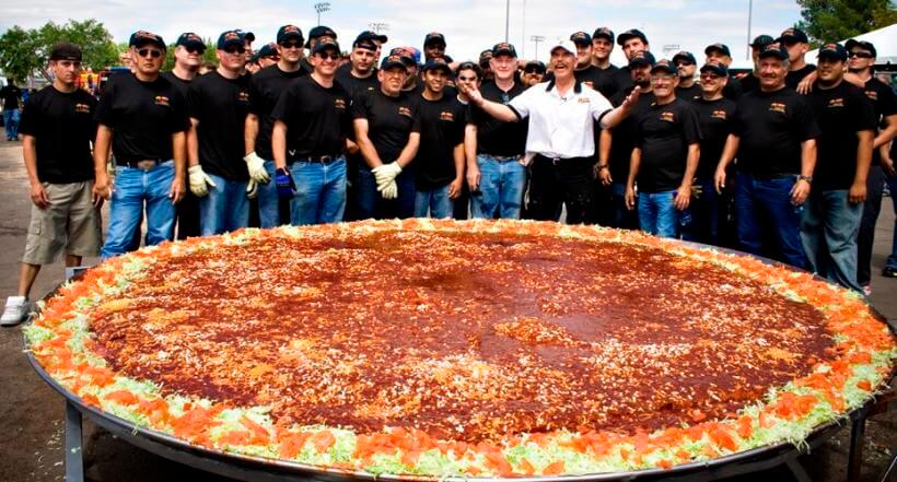 Robert V. Estrada and colleagues with his massive enchilada - Photo Courtesy of New Mexico Tourism