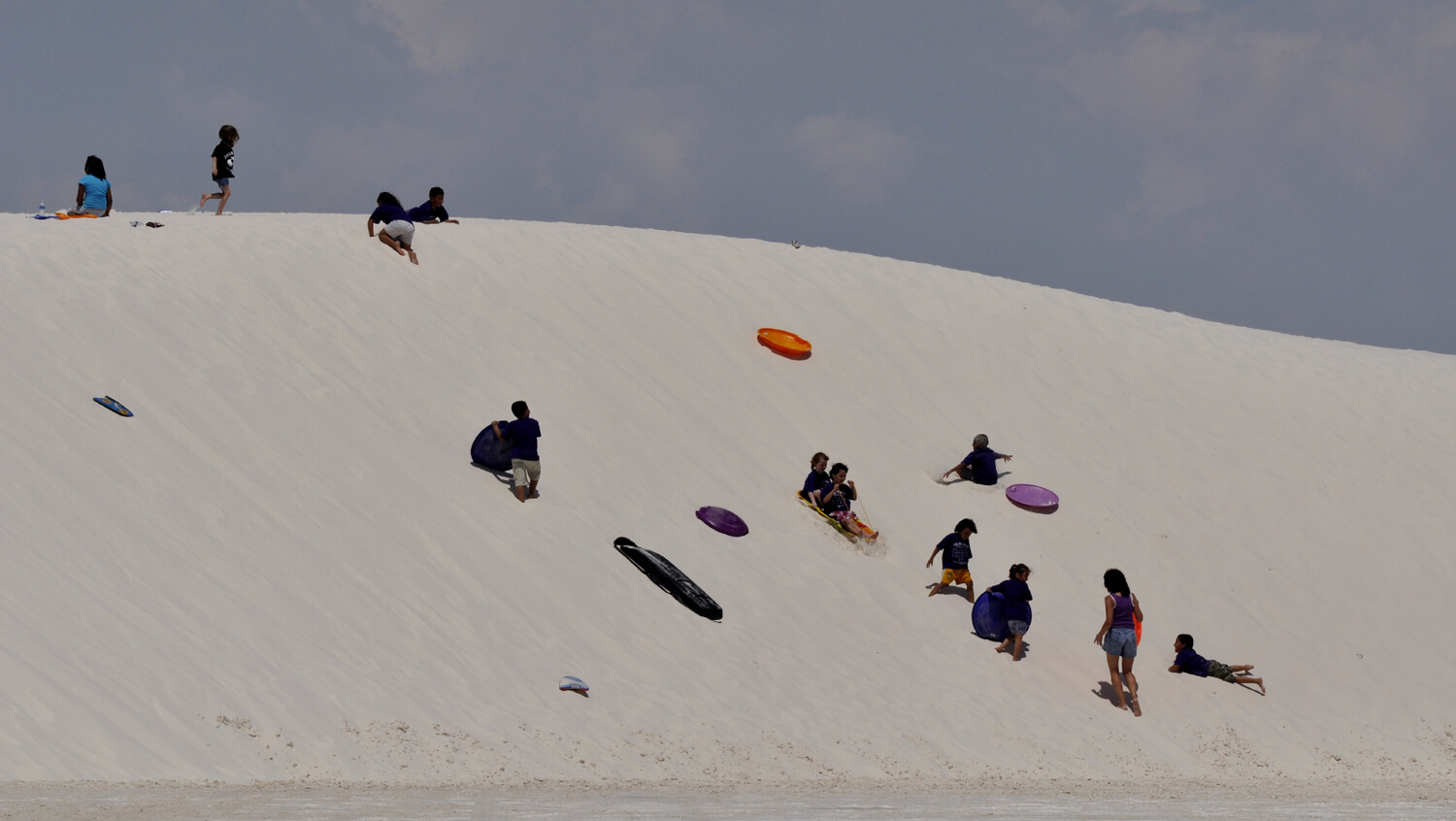Sledding at White Sands National Monument - Photo by ap0013