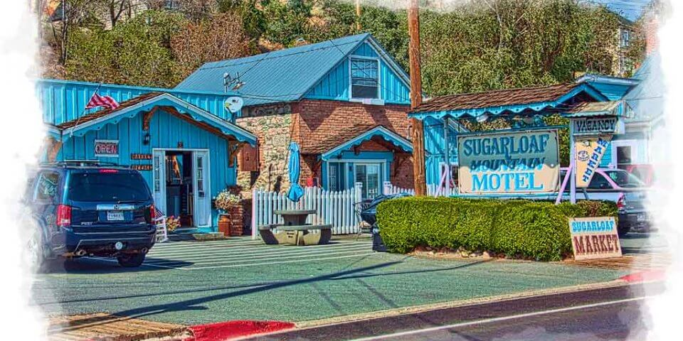 Sugarloaf Mountain Motel. A quaint light blue colored inn that happens to be a haunted place in Nevada. - Photo by Brent Cooper
