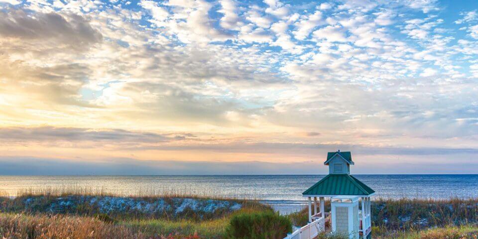 stjamesplantation.com/wp-content/uploads/2014/02/rev_beach-private-club-clouds-ocean-st-james-plantation-oak-island-nc.jpg