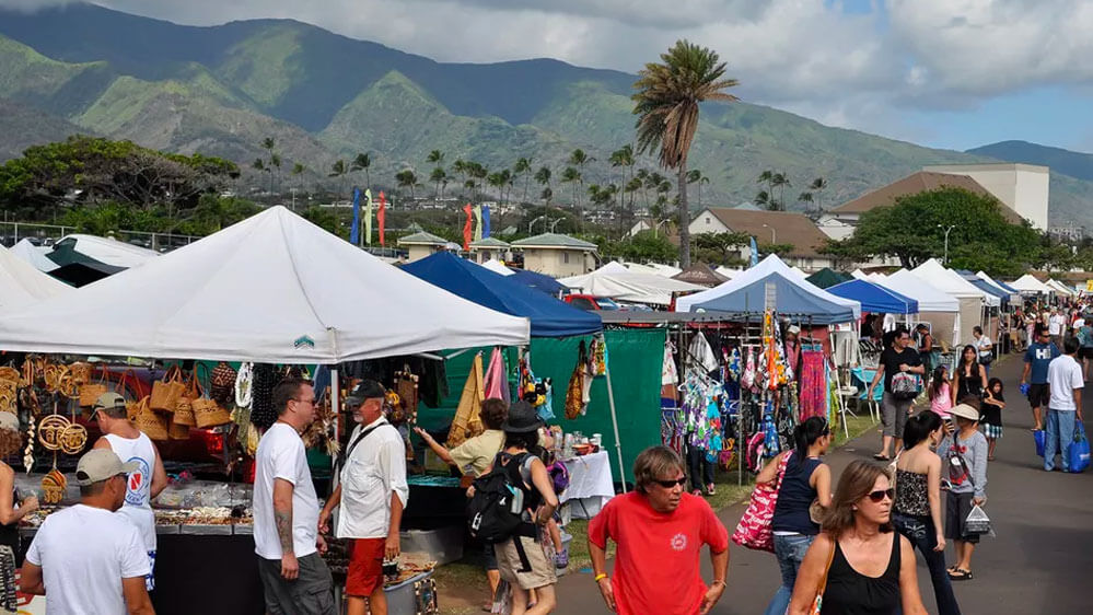 Tourists enjoy a nice day at the Maui Swap meet in Kahului