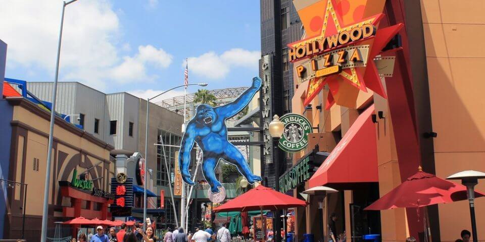 Cutout of King Kong hangs from the Hollywood Pizza sign at Universal Studios Hollywood.