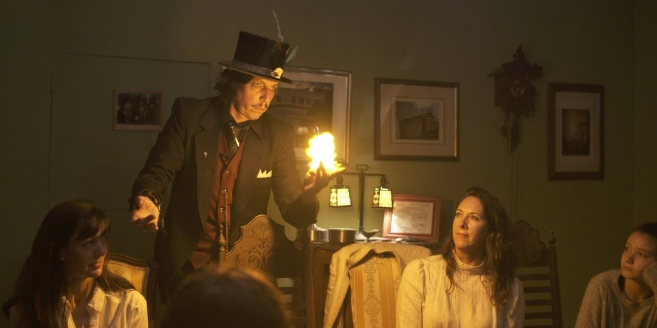 Magic Kenny Bang Bang conjuring spirits in the Bisbee Seance Room in downtown Bisbee, Arizona.